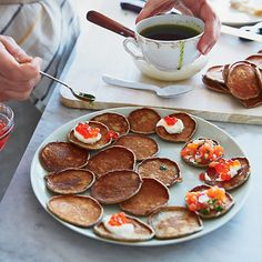 Quick Buckwheat Blini | Called oladyi or blinchiki (the diminutive of blini), these mini blini get their nutty flavor from buckwheat flour. They require no rising; Anya von Bremzen's mother, Larisa, uses this recipe to make a big batch quickly.