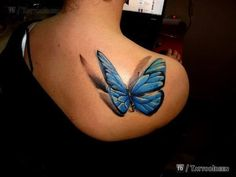 This Blue Butterfly tattoo looks so lifelike a flutter.