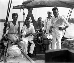 """Robert N. Cook 29 from right his wife Lenore both of Chicago Paul and Buck Evans and Don Dickson left of Evanston aboard the Swordfish in Belmont Harbor before they left to sail around the world June 14 1930. The group expected to sail for three years on the 46-foot topsail schooner. The Tribune reported: """"The route of the boat will be via the great lakes and through the Welland and Erie canals into the Hudson river. From New York harbor they will sail for the West Indies. Then to the Panama…"""