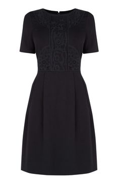 This lace detail shift dress is constructed from a mid weight jersey with stretch and features a round neck, a concealed zip on the back, two front pockets and pleat detailing on the skirt. Height of model shown: 5ft 10 inches/178cm. Model wears: UK size 10.Fabric:Lace: 100.0% Polyester.  Main: 69.0% Viscose