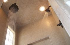 Bathroom remodel that uses 2 shower heads for total coverage