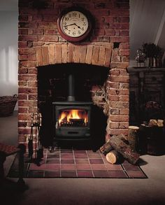Exposed brick chimney breast with log burner Wood Stove Hearth, Wood Burner Fireplace, Home Fireplace, Fireplace Design, Fireplace Ideas, Airstone Fireplace, Brick Fireplaces, Electric Fireplaces, Concrete Fireplace