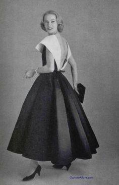 Model wearing a dress by Chanel, 1957.