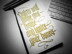 Lights will guide you. Blackletter calligraphy. Nice flourishes.