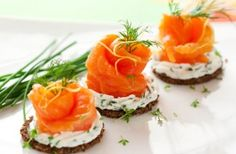 Smoked salmon roses on rye toasts recipe - good idea for a party or something.