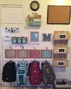 Finished my command center/backpack wall! Mail rack and wooden file rack from HomeGoods. Calendar, clock, cork board, frames from Walmart. Metal letter from . Backpack Wall, Backpack Hooks, Backpack Storage, Cheap Home Decor, Diy Home Decor, Family Command Center, Command Centers, Command Center Kitchen, Home Organisation
