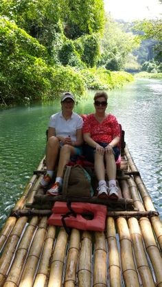 Peacefully floating on a handmade bamboo raft down the Martha Brae River, Falmouth, Jamaica.