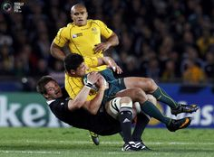 New Zealand All Blacks captain Richie McCaw (bottom) tackles Australia Wallabies' Anthony Faingaa during their Rugby World Cup semi-final match at Eden Park in Auckland October 16, 2011.
