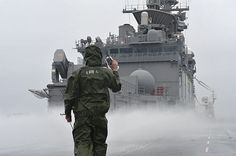 EAST CHINA SEA (May 10, 2013) A Sailor maintains radio communication with the bridge while participating in a counter-measure wash down evolution on the flight deck aboard the amphibious assault ship USS Bonhomme Richard (LHD 6). Bonhomme Richard is underway preparing for her Board of Inspection and Survey (INSURV). (U.S. Navy photo by Mass Communication Specialist 3rd Class Michael Achterling/Released).