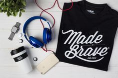 T-shirt flat lay photography by MadeBrave. Featuring headphones, iPhone, Apple…