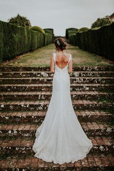 Bride in Lusan Mandongus Wedding Dress - Darina Stoda Photography   Jenny Packham Headdress   Pastel Green & White Wedding at Mount Ephraim Gardens