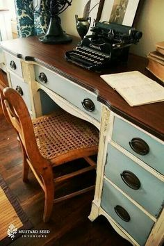 Desk with brown top, blue drawers, and brown handles.