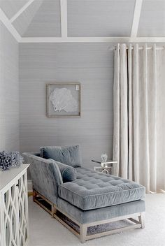 Gray grasscloth and velvet chaise.