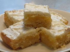 Melt in Your Mouth Lemon Bars- STOP!!! don't pass this recipe by, lemon lover or not these bars are SO melt in your mouth you'll want to eat the whole pan. Everyone loves them! Blue ribbon winner.