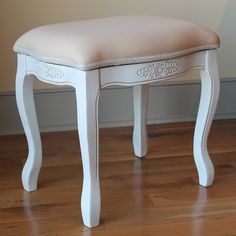 Sit pretty when fixing your hair and makeup with this antique whitecarved wood vanity stool from International Caravan. The delicatefloral hand engravings and soft beige cotton-polyester upholsteryadd