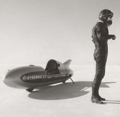Driver Bob Leppan and the Gyronaut X-1. Running twin Triumph Bonneville motors fit with 820cc kits and all the best performance gear of the time, the Gyronaut earned the title of World's Fatest Motorcycle on the Bonneville Salt Flats. The record was won in 1966 with an averaged speed of 245.667mph (395kph) which remained unbroken for 4 years.