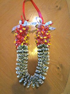 Candy Money graduation Lei with cherry and watermelon jolly ranchers and dollar bills! Money Lei, Money Origami, Homemade Gifts, Diy Gifts, Coach Appreciation Gifts, Graduation Leis, Jolly Rancher, Candy Bouquet, Grad Parties