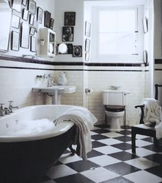 bathroom, clawfoot tub, pedestal sink, checkered floor, collage wall