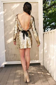 I love everything about this dress; the low back, the sparkles, the bow! So elegant and so classy.