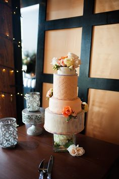 Peach and silver vintage, art deco inspired wedding cake.