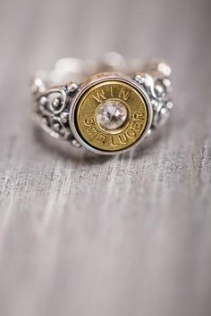 This unique 9mm Silver Bullet Casing Ring is a stunning representation of filigree metalwork, integrating a mix of sterling, brass, and crystal with the 9mm shell casing to form a beautiful silver bullet ring. #bourbonandboots #madeinthsouth #southernliving #southernstuff #southerngifts #valentinesgiftforher #valentinesday #forher #jewelry #southernjewelry #ring