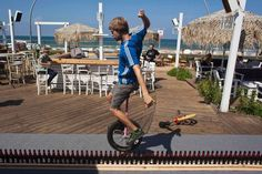 Guinness World Records - World's longest unicycle ride Lultz Eichholz from Germany set the world record by riding his unicycle over a 29.3-foot-long course of 127 beer bottles in September 2011.