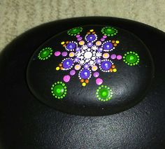 Hand painted mandala stone by TouchstoneArt on Etsy