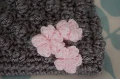 Three of these sweet, puffy flowers were the appliques on my Bobblicious Baby Hat . For the flower on the far left, I used a 5 mm (H/8)...