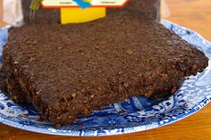 Genuine PUMPERNICKEL BREAD is very dark and heavy. It's made from unrefined, unbolted rye flour and baked slowly for 16 to 24 hours. No artificial colouring or flavouring (including caraway seed) is allowed by law. American deli-style pumpernickel looks and tastes completely different. It's made from white wheat flour with some refined rye flour added, and artificially coloured with molasses, cocoa powder or coffee. There are often caraway seeds. http://www.cooksinfo.com/pumpernickel-bread