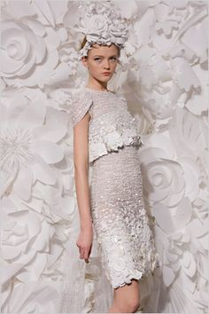 We are loving all the paper flowers blooming this spring! It all started with Chanel's spring fashion show featuring over the top white paper floral headpieces and backgrounds which made the all white collectionanything but boring…