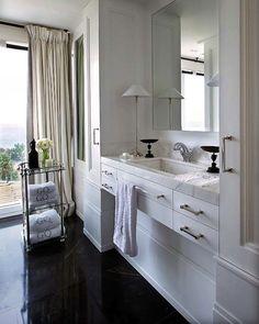 Nuevo Estilo: Pablo Paniagua - Chic master bathroom with polished black marble tile bathroom floor. ...