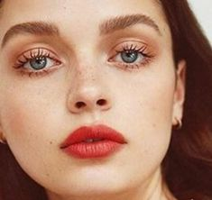 Natural brows, eyelashes together, bitten-red lips
