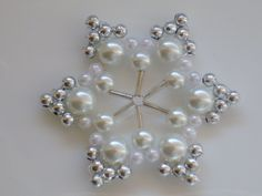 close up of a beaded snowflake