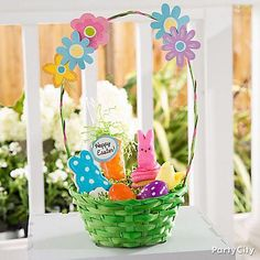 Create a basket bursting with Spring color! Fill a green basket with a couple treat-filled eggs and sweets like a Peeps®-topped cupcake. For the final floral touch, stick a couple flower cutouts to the basket handle!