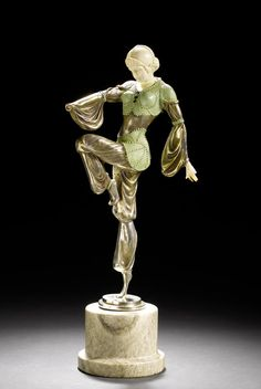 Continental a silvered and cold-painted bronze and carved ivory figure in the style of A. Goddard, circa 1925