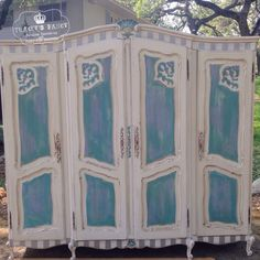 """Classic French Armoire transformed.  With a soft color palette of linen, teal, lilac and silver then tastefully distressed, we bring """"Old World Charm"""" new life!"""
