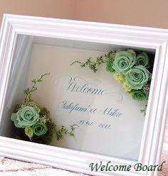 花嫁さまの手作り☆ウェルカムボード☆中央の文字はカリグラフィの先生の直筆。文字色はお花の色と合わせてあります。オンリーワンのウエルカムボード、挙式後もご自宅に飾れます。