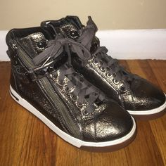 Michael Kors Metallic Studded Sneakers Size 9.5 Awesome MK sneakers, these are not wedges and are super comfortable. In great condition! Size 9.5 Michael Kors Shoes Sneakers