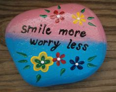 """Painted rock """"Smile more, worry less"""""""