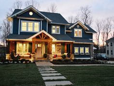 blue exterior home with wood porch - Google Search
