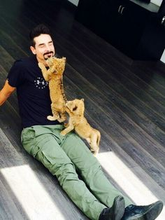 Kevin Richardson and baby lions