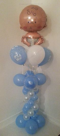 Baby Boy Balloon Column. Helium filled with four helium filled latex balloons attached to a matching column.    The column features double bubble 'its a boy' balloons. Very pretty display that stands 77 inches tall. https://www.facebook.com/balloonsglasgow