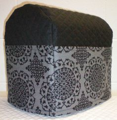 Check out this item in my Etsy shop https://www.etsy.com/listing/160004351/black-gray-quilted-medallion-damask