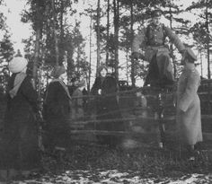 Tsar Nicholas II of Russia and his daughters at army headquarters with Grand Duke Dmitri Pavlovich Romanov of Russia in 1916.A♥W