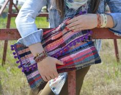 This whimsical and fun clutch is sure to attract attention. Each bag is made of a kourelou which is a small rag made of various fabric scraps originally used for t-shirts. This means that no two bags are identical. Kourelou rugs are very commonly used in the Greek islands and they always reminded me of summer holidays. I created my kilim bags to hold onto this memory all year long!  The last photo is from the fab blog El for Elegant life that featured my work, http://elforelegantlif...