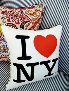 I want to learn how to sew just to make pillows like this! These are made from I Love NY TOTE BAGS!? I know! It's genius.