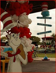 Cat in the hat themed cake table decoration.  http://www.dreamarkevents.com/ #Dr.Seuss #catinthehat #party #kidsparty #decoration #draping #centerpiece #partydecoration #ballooncolumns #balloonarch #balloondecoration #Themedparty #parkpavilion #parkdecoration #Kidsentertainment #thingone #thingtwo #drsuess #partydecoration #partyplaner #fortlauderdale #miami #bocaraton #palmbeach