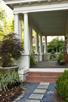 flagstone pavers and front porch---love the side entrance to this porch