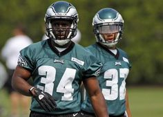 Philadelphia Eagles running backs Bryce Brown, left, and Chris Polk listen during an NFL football rookie minicamp at their training facility, Saturday, May 12, 2012, in Philadelphia. (AP Photo/Alex Brandon)