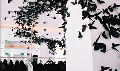 Andrea Mastrovito's butterfly installation at the Dior Homme store in Paris